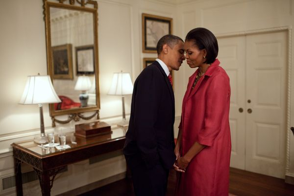 The Obamas wait in the Map Room of the White House before welcoming President Felipe Calderón of Mexico on May 19, 201