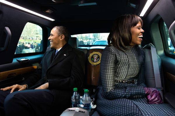 President Barack Obama and first lady Michelle Obama ride in the inaugural parade in Washington, D.C. on Jan. 21, 2013.