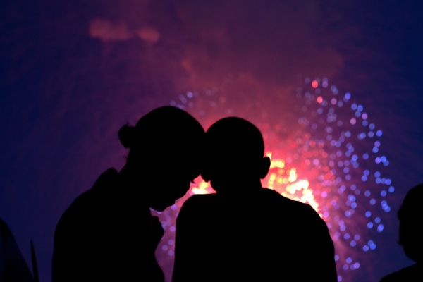 President Barack Obama and first lady Michelle Obama watch the fireworks over the National Mall from the roof of the Whi