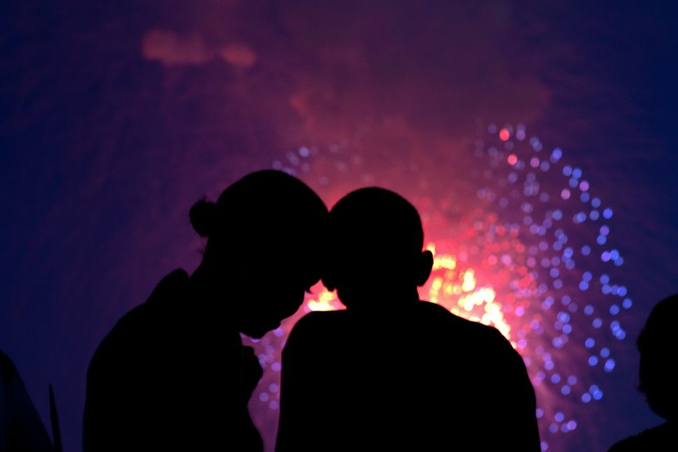 President Barack Obama and first ladyMichelle Obama watch the fireworks over the National Mall from the roof of the Whi