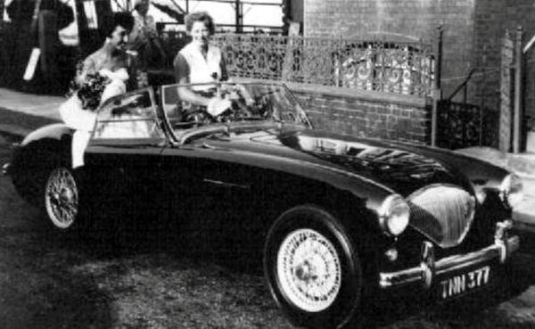 Collect picture of Helen Andre (left) in a sports car which was paid for by Davy Moakes's father to meet Davy at a ball in 19