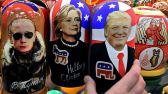 TOPSHOT - Traditional Russian wooden nesting dolls, Matryoshka dolls, depicting Russia's President Vladimir Putin, US Democratic presidential nominee Hillary Clinton and US Republican presidential nominee Donald Trump are seen on sale at a gift shop in central Moscow on November 8, 2016. A nervous world turned its gaze to America's 200 million-strong electorate November 8, 2016 as it chooses whether to send the first female president or a populist property tycoon to the White House. / AFP / Kirill KUDRYAVTSEV        (Photo credit should read KIRILL KUDRYAVTSEV/AFP/Getty Images)