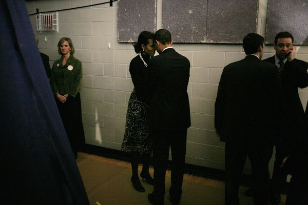 Then-Sen. Barack Obama and Michelle Obama backstage before a primary rally in the gymnasium at Nashua South High School in Na