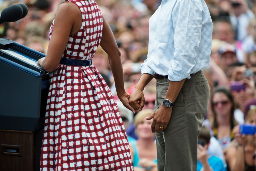 Michelle Obama and President Barack Obama speak during a rally at Alliant Energy Amphitheater in Dubuque, Iowa on Aug. 15, 20