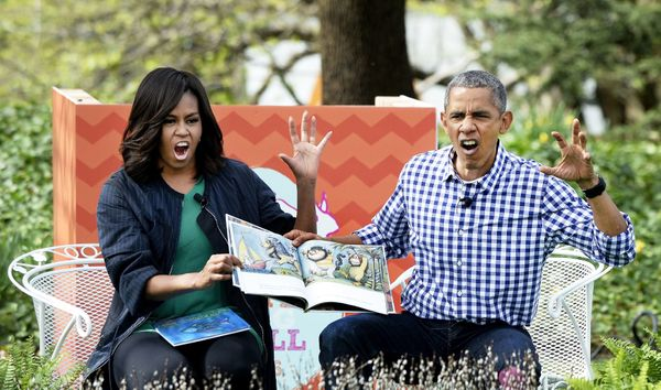 President Barack Obama and first lady Michelle Obama imitate monsters as they read <i>Where The Wild Things Are</i> during th