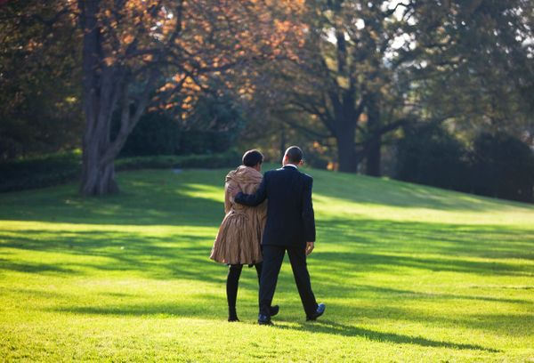 Barack Obama and Michelle Obama walk toward Marine One across the South Lawn of the White House.