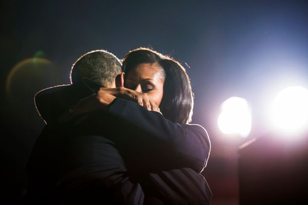 The Obamas hug at a campaign rally in Des Moines, Iowa.