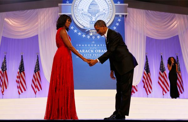 President Barack Obama bows to first lady Michelle Obama at the Inaugural Ball in Washington on Jan. 21, 2013.