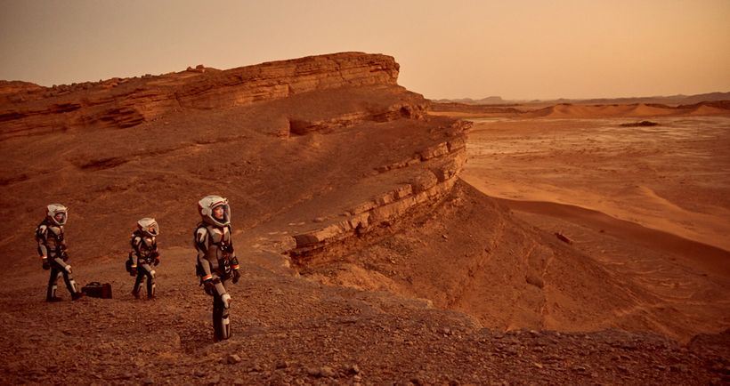 Some of the crew exploring Mars.