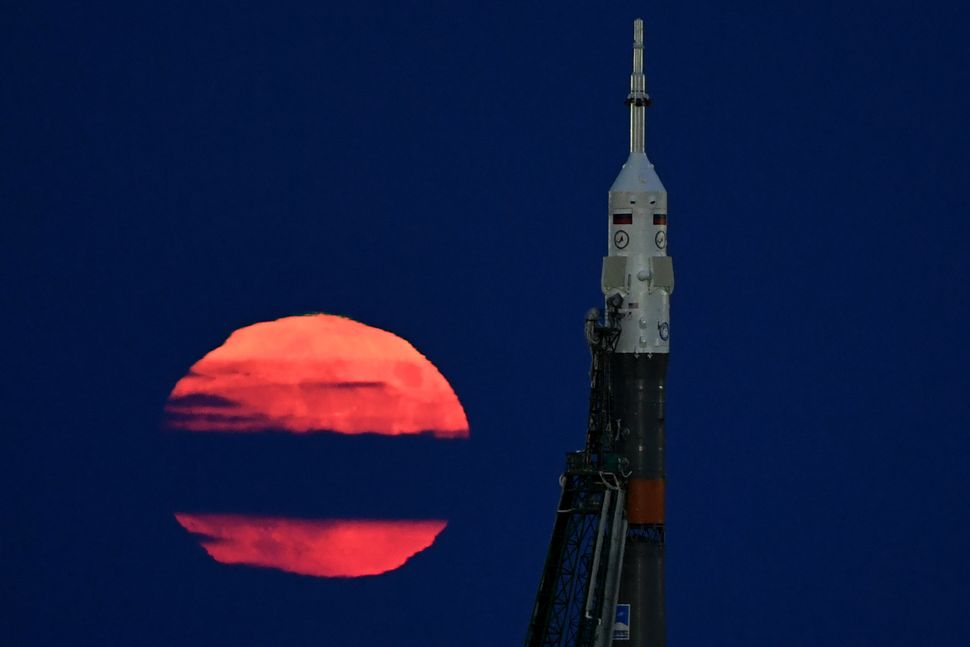 The supermoon is seen Monday behind the Soyuz MS-03 spacecraft set on the launch pad at the Russian-leased Baikonur cosmodrom