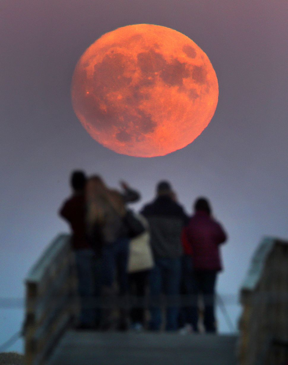 A supermoon rises at 4:14 p.m. Sunday in Plymouth, Massachusetts.