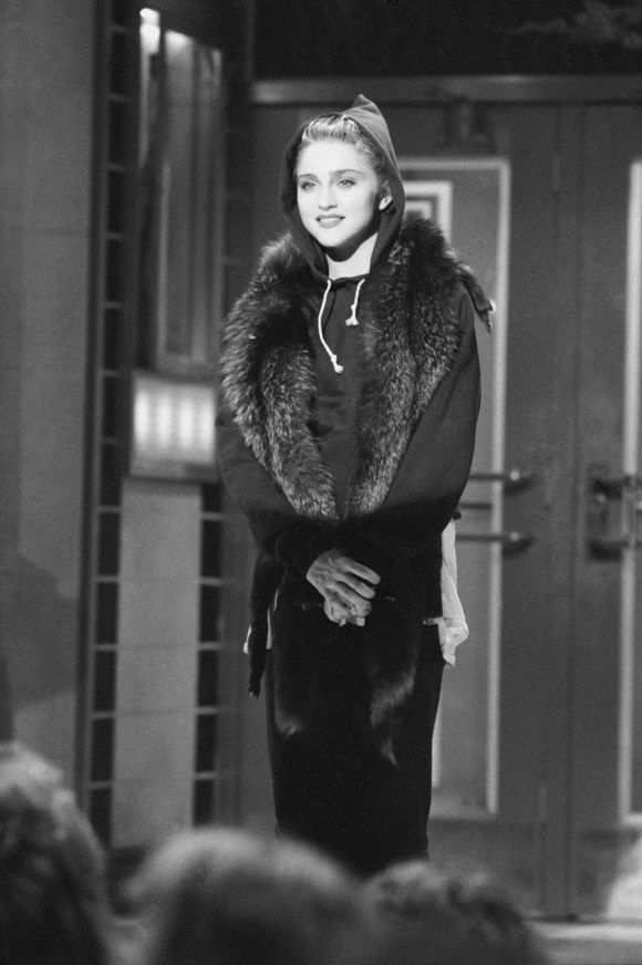 <p>Madonna wearing a hoodie on the set of<em>Saturday Night Live </em>in 1985.</p>