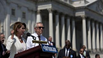 House Minority Leader Nancy Pelosi, a Democrat from California, left, speaks as Senate Minority Leader Harry Reid, a Democrat from Nevada, right, listens during a news conference with U.S. Vice President Joseph 'Joe' Biden, not pictured, next to the House steps of the U.S. Capitol building in Washington, D.C., U.S., on Thursday, Sept. 8, 2016. Biden went to Capitol Hill to urge Republicans in Congress to take action on issues such as Zika funding and the seat vacancy at the U.S. Supreme Court. Photographer: Andrew Harrer/Bloomberg via Getty Images
