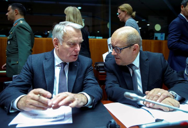 France Foreign Minister Jean-Marc Ayrault (L) and France's Defence Minister Jean-Yves Le Drian attend a European Union foreig