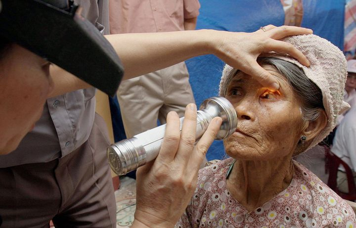 An elderly woman receives an eye examination for trachoma in Hiep Hoa village, in Thai Binh, Vietnam, July 6, 2005.
