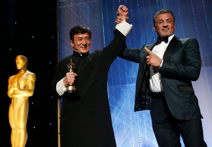 Sylvester Stallone congratulates Jackie Chan.
