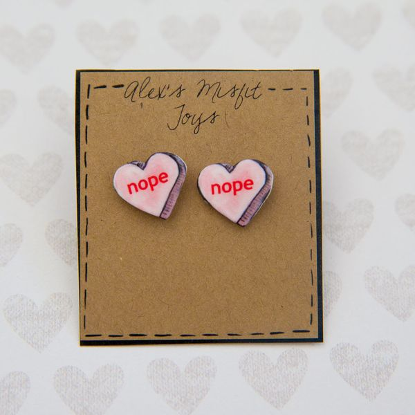 "Heart Pastel Nope Earrings, $6.50, <a href=""https://www.etsy.com/listing/292802097/sarcastic-conversation-heart-pastel-nope"""