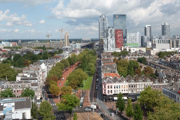 <em>Westersingel greenway stretching toward Rotterdam's Central Station.</em>