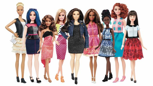 Graham's Barbie (center) is one of a kind, but the other new Barbies are available for