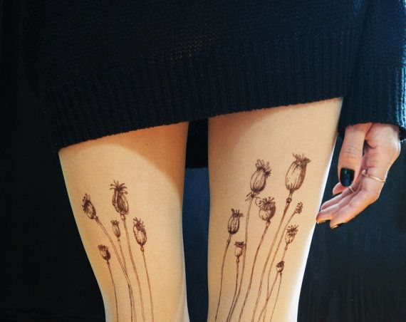 "Poppy tattoo tights, $27.55 at <a href=""https://www.etsy.com/listing/220451131/poppy-tattoo-tights-poppy-tattoo?ref=shop_home_active_3"" target=""_blank"">etsy.com/shop/TattooTightsTATUL</a>"