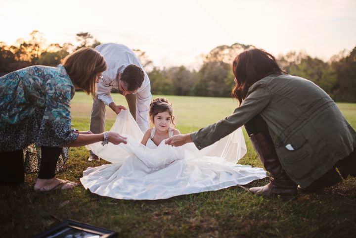 """""""It may have been emotional for us adults, but because Nora was so excited, we tried to make it happy for her,"""" the photographer said of the photo shoot."""