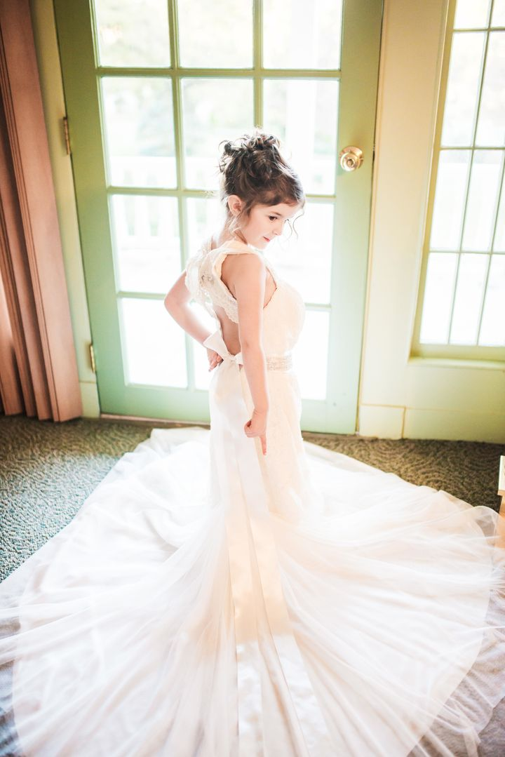4d28c0061a8 Little Girl Poses In Late Mother s Wedding Dress In Beautiful Photo ...