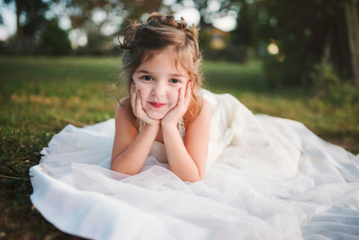 Little Girl Poses In Late Mother\'s Wedding Dress In Beautiful ...