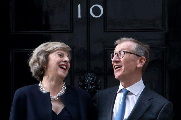 Theresa May and her husband Philip John May outside 10 Downing