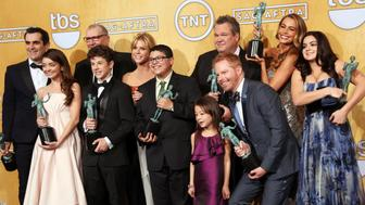 """FILE - In this Jan. 18, 2014, file photo, the cast of """"Modern Family"""" poses with their awards for outstanding performance by an ensemble in a comedy series fat the 20th annual Screen Actors Guild Awards at the Shrine Auditorium in Los Angeles. ABC has confirmed that a transgender child actor will guest star on the series in an episode set to air Wednesday, Sept. 28, 2016. (Photo by Matt Sayles/Invision/AP, File)"""