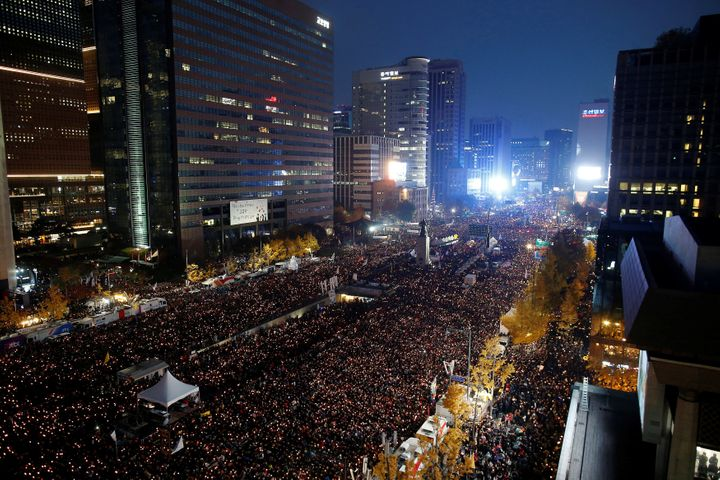 People take part in a rally calling for President Park Geun-hye to step down in central Seoul, South Korea, November 12, 2016