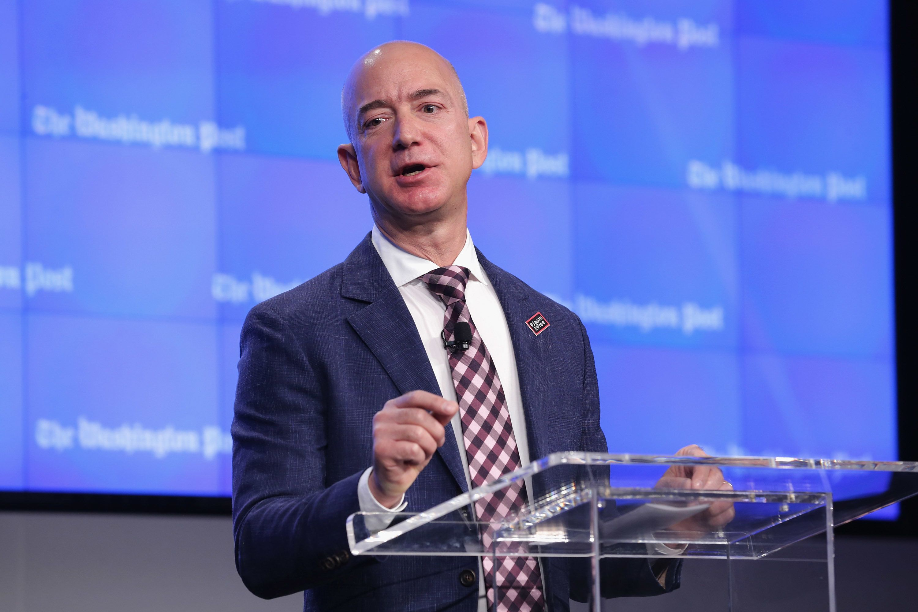 WASHINGTON, DC - JANUARY 28:  Amazon founder and Washington Post owner Jeff Bezos delivers remarks during the opening ceremony of the media company's new location January 28, 2016 in Washington, DC. Bezos purchased the newspaper and media company in October of 2013 from the storied Graham family.  (Photo by Chip Somodevilla/Getty Images)