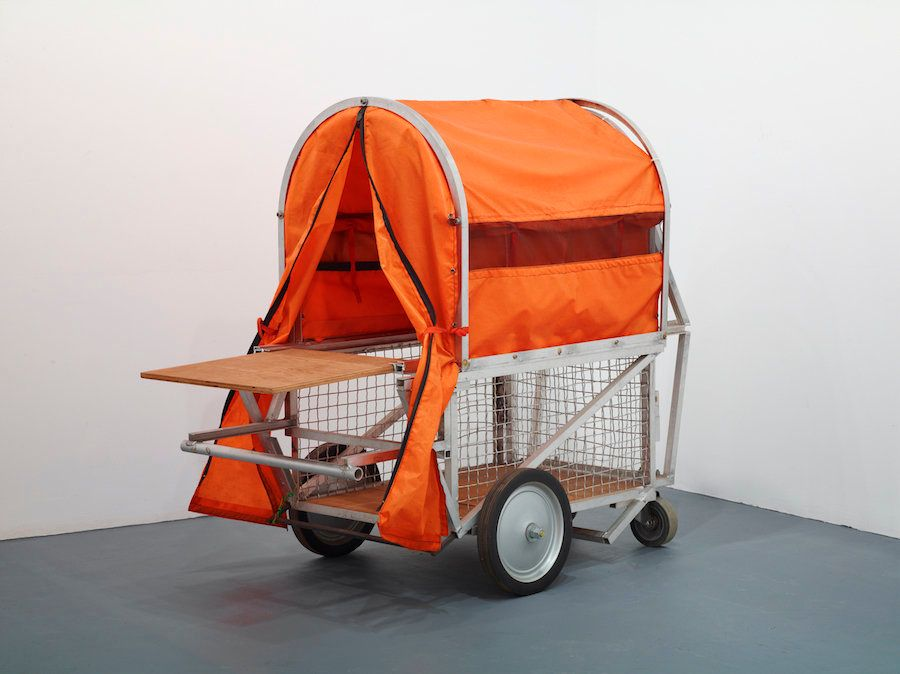"""Krzysztof Wodiczko, """"Homeless Vehicle, Variant 5,"""" c. 1985. Aluminum, fabric, wire cage, and hardware"""