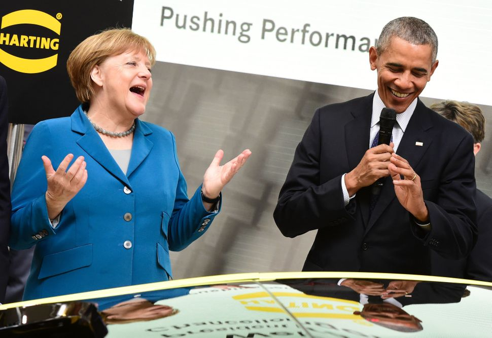 Obama and Merkel share a laugh as they tour the Hanover Industrial Fair in Hanover, central Germany, on April 25.