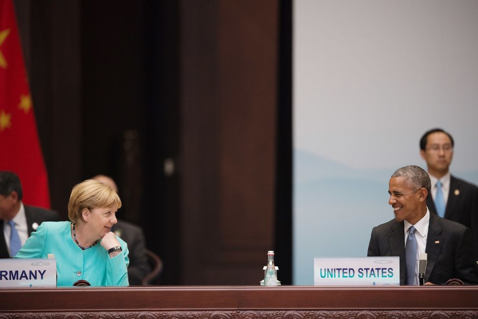 Merkel (L) chats with Obama during the opening ceremony of the G20 Leaders Summit on Sept. 4 in Hangzhou, China.