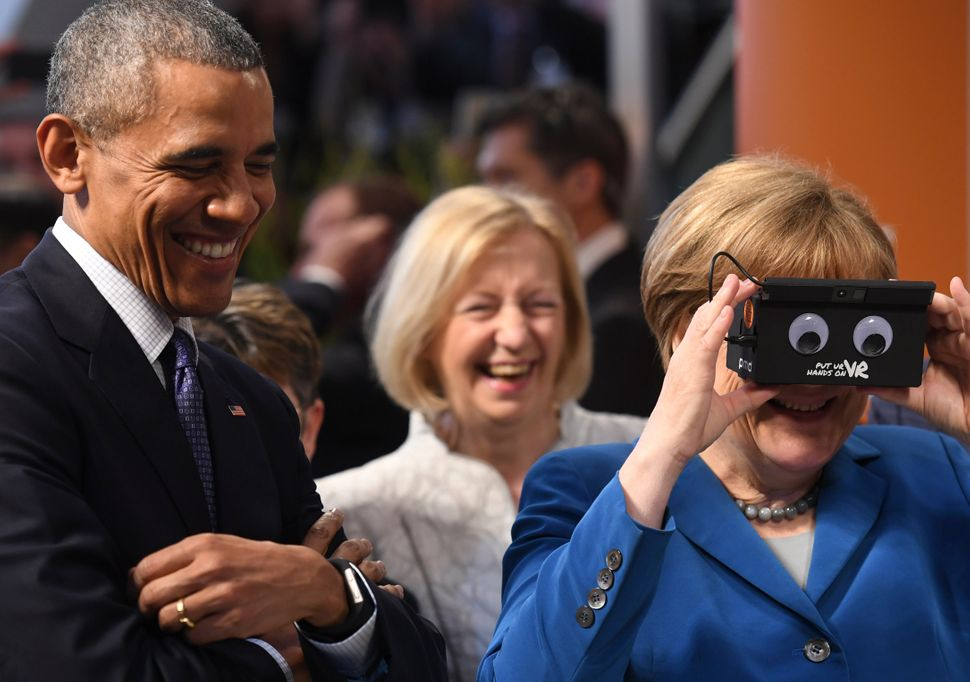 Obama and German Merkel visit the IFM electronics stand at the Hannover Messe industrial trade fair on April 25 in Hanov