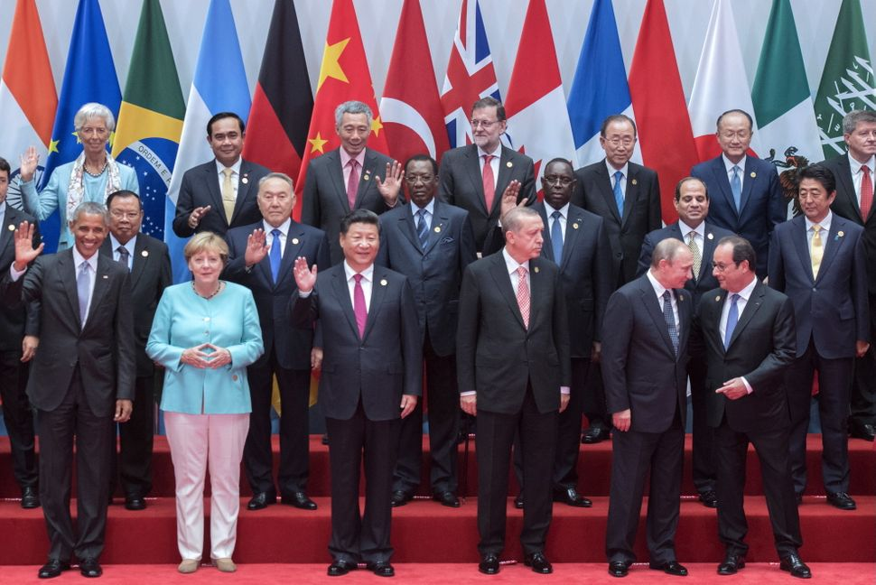 Obama, Merkel, and other world leaders pose for a family photo at the G20 summit in Hangzhou, China.