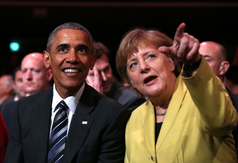 Obama and Merkel sit during the official opening ceremony of the Hanover Industrial Fair in Hanover, Germany, on April 24.