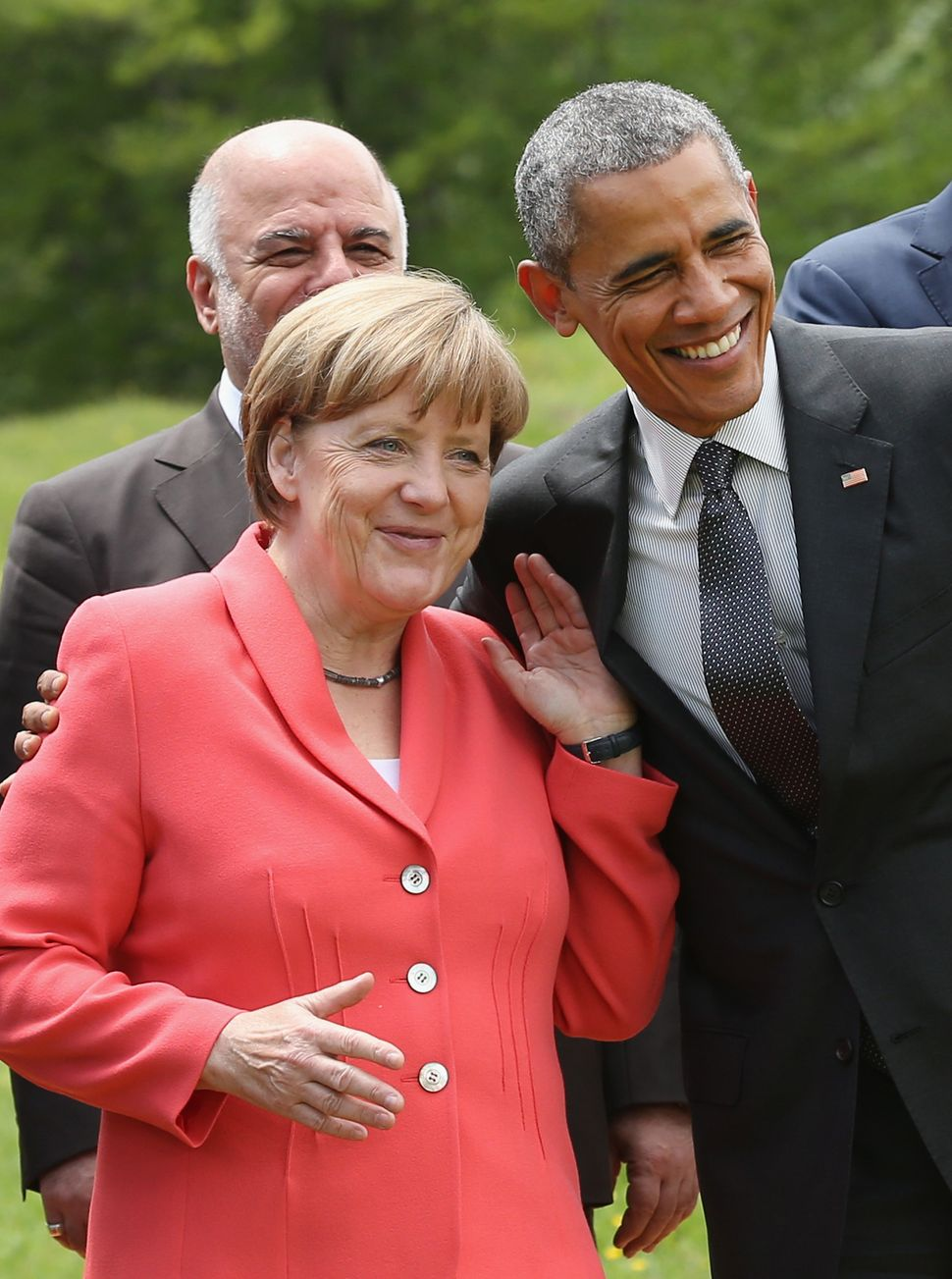 Merkel and Obama chat during the Outreach group photo on the second day of the summit of G7 nations at Schloss Elmau on June
