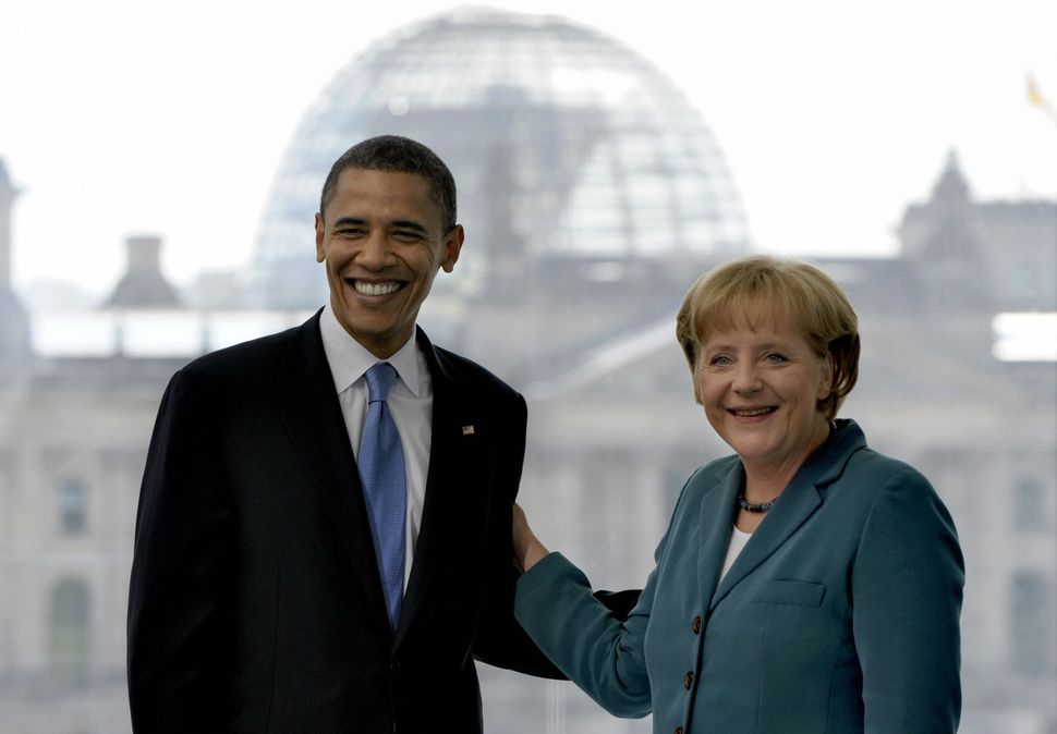 Merkel welcomes Obama during his run for president, on July 24, 2008, in Berlin.