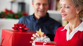 Woman Reads Gift Tag on Christmas Gift