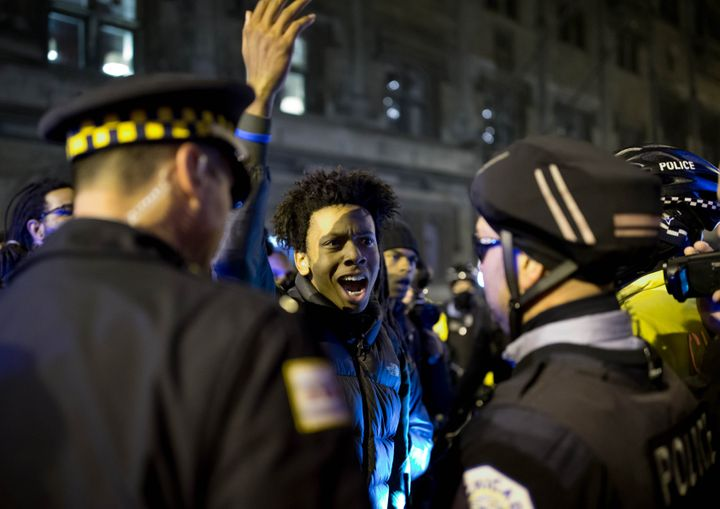 Protesters clash with the law enforcement during a 2015 protest of the police killing of Laquan McDonald in downtown Chi