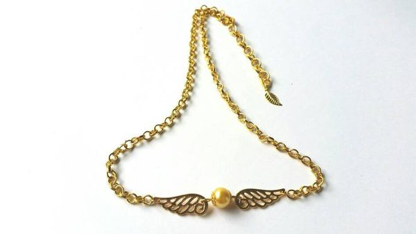 "Golden Snitch Necklace, $10, <a href=""https://www.etsy.com/listing/288175569/harry-potter-inspired-golden-snitch"" target=""_bl"
