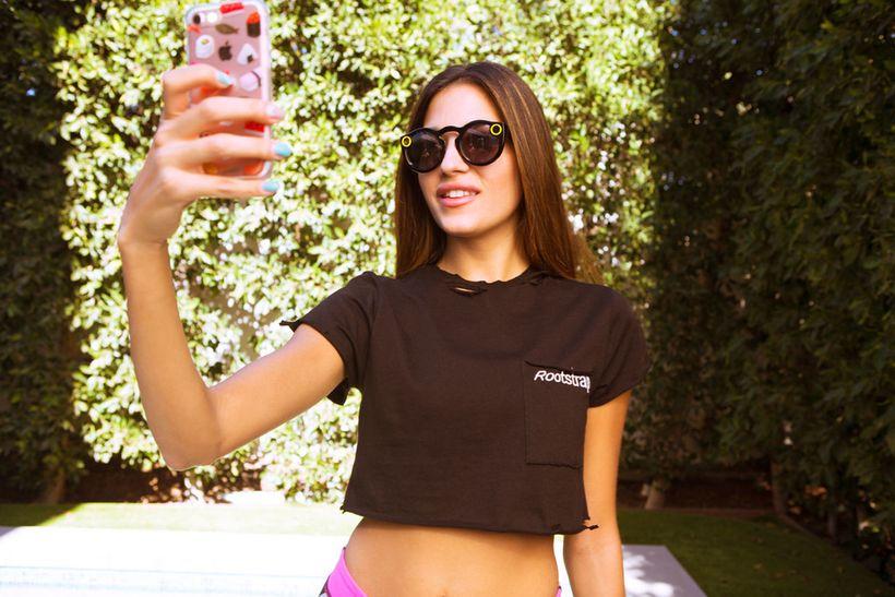 Tiffany Cohen tries out Snap's new Spectacles.  <em>Photo Credit: PaulDimalanta.com</em>