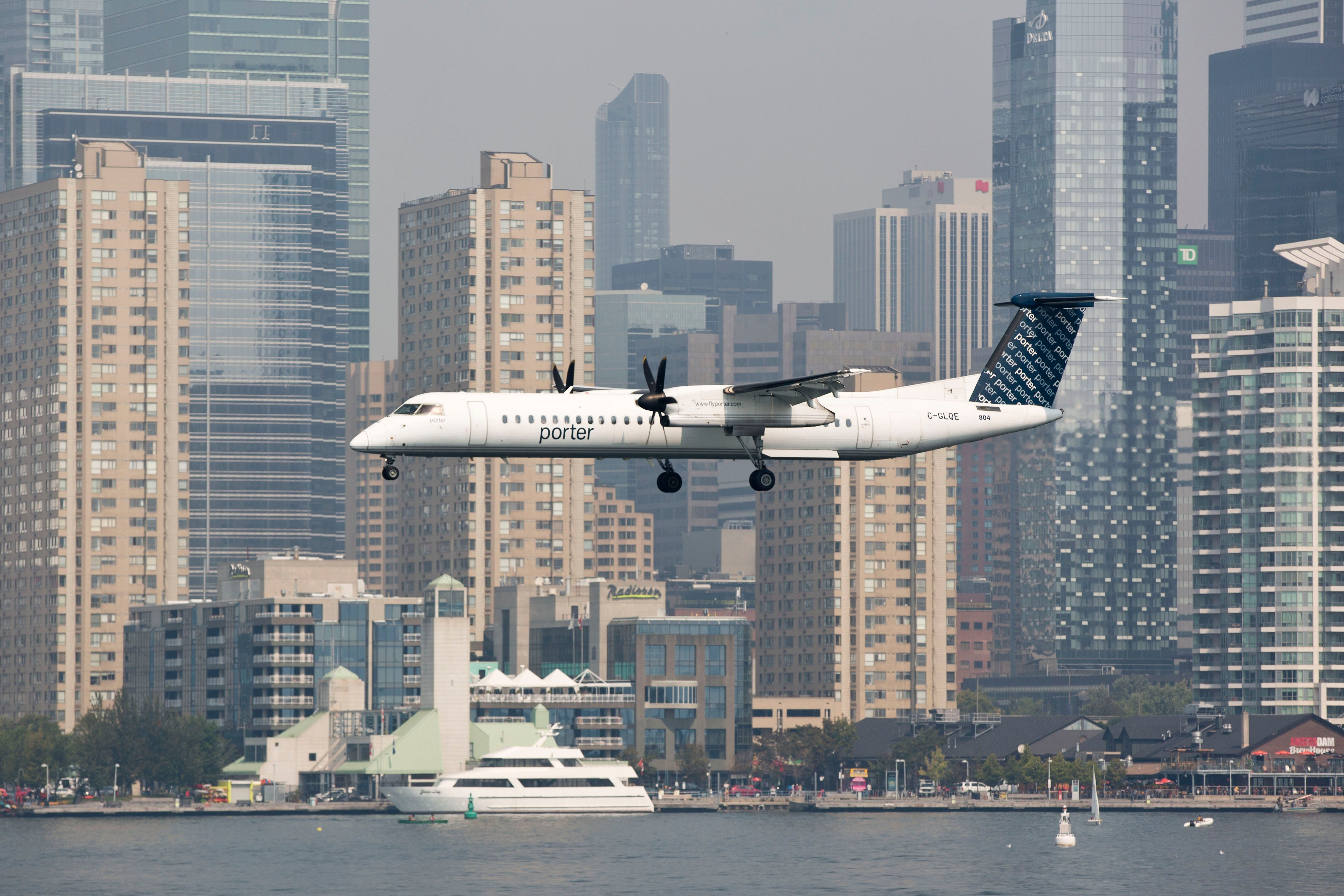 TORONTO, ON - SEPTEMBER 2: Toronto, On- Sep 2, 2015 A Porter Airline flight lands at Toronto's Billy Bishop Airport. Captain Duncan Rand runs the Mariposa's Oriole cruise ship in the Toronto harbour.        (Lucas Oleniuk/Toronto Star via Getty Images)