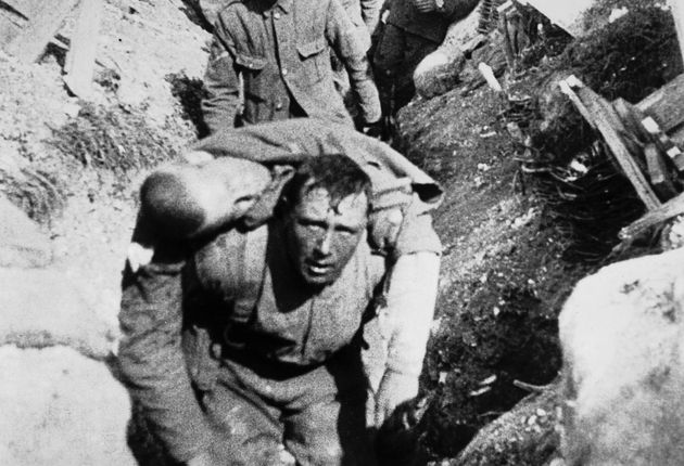A soldier carries a wounded comrade through the