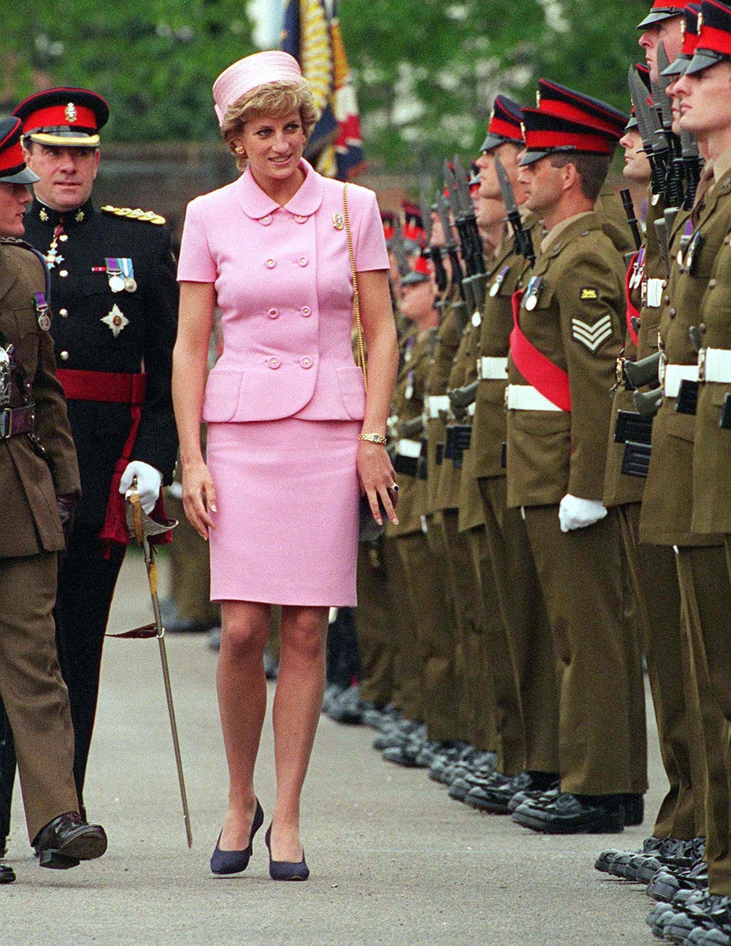 Princess Diana (1961 - 1997) inspecting members of the Queen's and Royal Hampshire Regiment during a visit to Howe Barracks, Canterbury, Kent, May 1995. She is wearing a Versace suit and a hat by Philip Somerville. (Photo by Jayne Fincher/Getty Images)