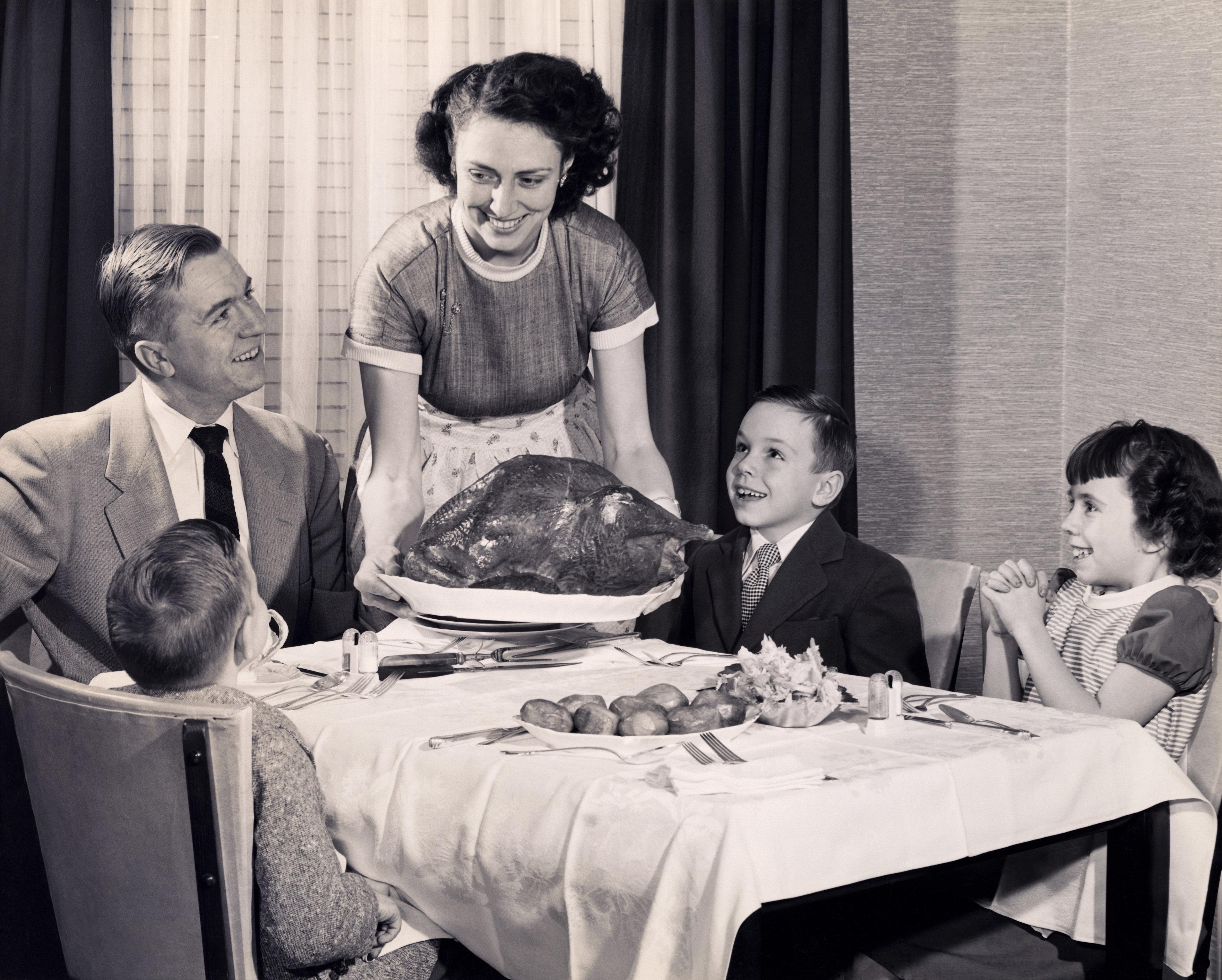 Mother serving a turkey on a platter