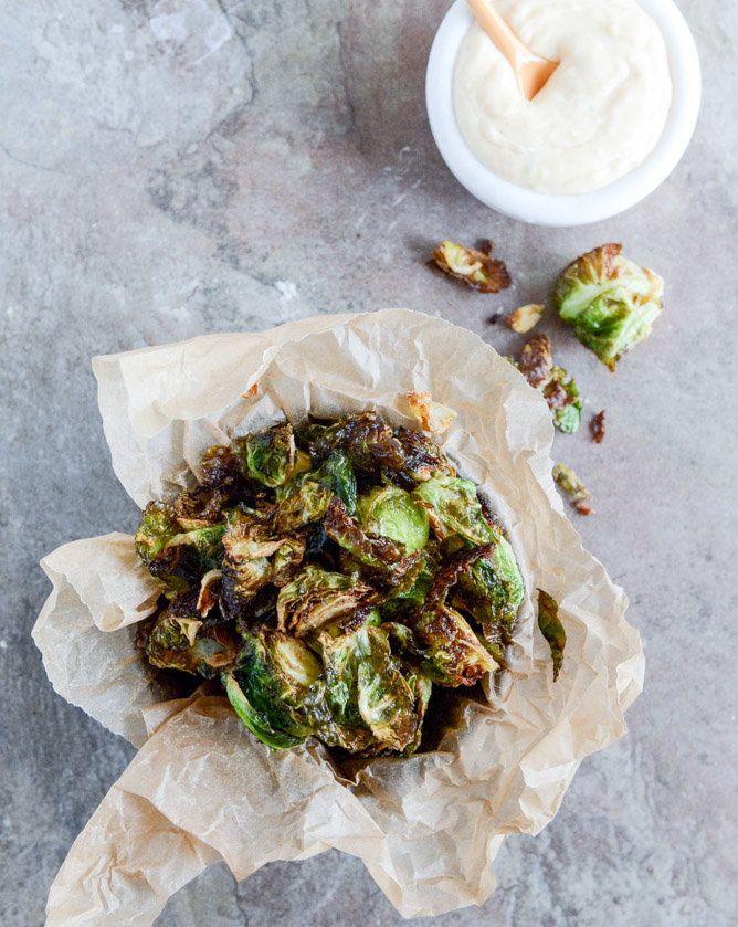 "<strong>Get the <a href=""http://www.howsweeteats.com/2013/12/fried-brussels-sprouts-with-smoky-honey-aioli/"" target=""_blank"">"