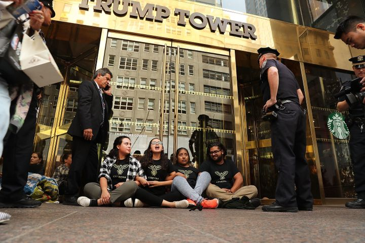 Protesters block the entrance to Trump Tower over Donald Trump's immigration policies in New York City before being arrested
