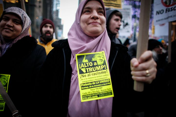 A Muslim woman holds a poster during a protest against Donald Trump on December 20, 2015 in New York.